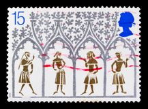 14th Century Peasants from Stained-glass Window, Christmas 1989 - 800th Anniversary of Ely Cathedral serie, circa 1989. MOSCOW, RUSSIA - OCTOBER 3, 2017: A stamp Stock Photography