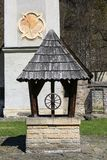 14th century Red Monastery, bell tower with sundial, wooden well, Slovakia.  stock photo