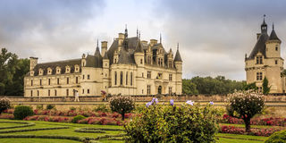 16th-century Renaissance palace in Loire, France. Chateau de Chenonceau.  The three-story structure extending to the left is on a bridge spanning the Cher River Royalty Free Stock Photography