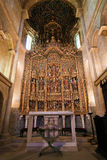 15th century retable in Coimbra Old Cathedral or Se Velha. Magnificent 15th Century retable in the Old Cathedral or Se Velha of Coimbra, Portugal, created by Royalty Free Stock Images