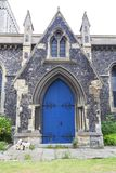 12th century Romanian style Church of St Mary the Virgin, Dover, United Kingdom. 12th century Romanian style Church of St Mary the Virgin,  blue door, Dover Stock Photos
