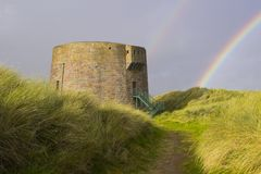 The 19th century round Martello tower fort built in the sand dunes at Magilligan Point near Limavady in County Derry in Northern I Stock Images