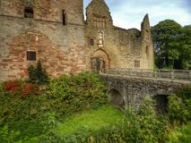 Bridge over moat of Ludlow Castle. 12th century ruins of Ludlow Castle in town of same name stock photo