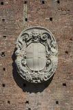 15th century Sforza Castle Castello Sforzesco, Milan, Italy. 15th century Sforza Castle Castello Sforzesco, stone coat of arms on facade, Milan, Italy royalty free stock image