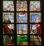 15th Century Stained Glass in Antwerp. Stained Glass window in the 15th Century Elzenveld Chapel in Antwerp, Belgium, depicting a couple kneeling before Christ Royalty Free Stock Image