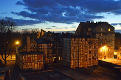 19th century timber frame houses. In Toruń shortly after sunset. Post and beam construction. Blue clouds stock photo