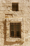 14th Century Window. Windows on a 14th century limestone building Stock Image