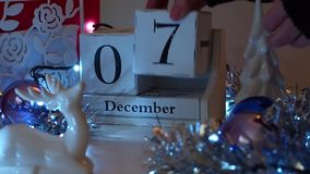 7th December Date Blocks Advent Calendar. Date calendar blocks turning during Christmas Advent set in a festive scene. Ideal to reveal days in December