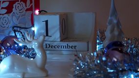 15th December Date Blocks Advent Calendar. Date calendar blocks turning during Christmas Advent set in a festive scene. Ideal to reveal days in December