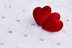 14th februari datum och röd hjärta Royaltyfri Foto