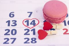 14th february on calendar. 14th February marked with a heart on calendar and wooden pins with red hearts. Close up. St.Valentine`s concept Royalty Free Stock Image