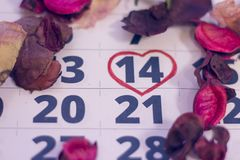 14th february on calendar. 14th February marked with a heart on calendar and wooden pins with red hearts. Close up. St.Valentine`s concept Royalty Free Stock Photo