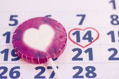 14th february on calendar. 14th February marked with a heart on calendar and wooden pins with red hearts. Close up. St.Valentine`s concept Stock Photography