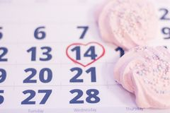 14th february on calendar. 14th February marked with a heart on calendar and wooden pins with red hearts. Close up. St.Valentine`s concept Royalty Free Stock Images