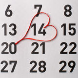 14Th of February calendar reminder with a red satin heart. Royalty Free Stock Photos