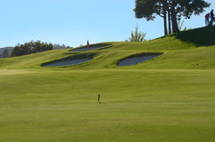 18th green and green bunkers Stock Photography
