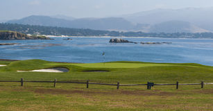 18th Green at Pebble Beach Golf Resort. A beautiful ocean view on the 18th green at prestigeous Pebble Beach in Monterey California Royalty Free Stock Images