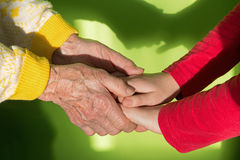 Th hands of grandmother and grandchild Royalty Free Stock Images