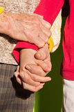 Th hands of grandmother and grandchild Stock Photos