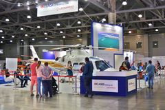 People visit 11th international exhibition of helicopter industry HeliRussia 2018. 11th international exhibition of helicopter industry HeliRussia 2018. Public Royalty Free Stock Images