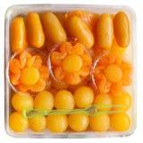 Th intrappolato di gocce dei rossi d'uovo dell'oro e dei rossi d'uovo dell'oro Fotografie Stock