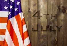 4th Juli, USA-självständighetsdagen, ställe som ska annonseras, wood bakgrund, amerikanska flaggan Royaltyfri Bild