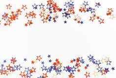 4th of July American Independence Day blue and red stars decorations on white background. Flat lay, top view, copy space.Red and blue stars border for American royalty free illustration
