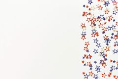 4th of July American Independence Day blue and red stars decorations on white   background. Flat lay, top view, copy space.Red and blue stars border for Royalty Free Stock Photography