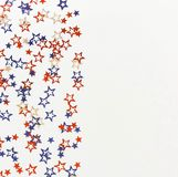 4th of July American Independence Day blue and red stars decorations on white   background. Flat lay, top view, copy space.Red and blue stars border for Stock Photography