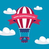4th of july American independence day greeting card with hot air balloon in american flag colors with red ribbon. Stock Photo