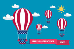 4th of july American independence day greeting card with hot air balloons in american flag colors with red ribbon. Flat design vector illustration Stock Images
