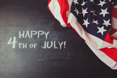 4th of july background with chalkboard and USA flag Royalty Free Stock Photo
