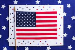 4th of July. Concept for Independence Day with red and blue paper stars confetti and flag in national American colors. stock photos