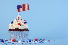 4th of July cupcake with flag, sprinkles. 4th of July cupcake with flag and sprinkles Royalty Free Stock Images