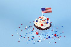 4th of July cupcake with flag, sprinkles. 4th of July cupcake with flag and sprinkles Royalty Free Stock Photo