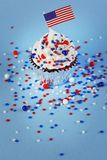 4th of July cupcake with flag, sprinkles. 4th of July cupcake with flag and sprinkles Royalty Free Stock Photography