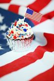 4th of July cupcake with flag, sprinkles. 4th of July cupcake with flag and sprinkles Royalty Free Stock Photos