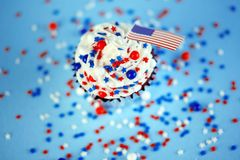 4th of July cupcake with flag, sprinkles. 4th of July cupcake with flag and sprinkles Royalty Free Stock Image