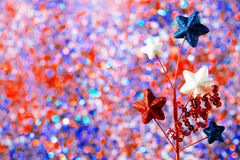 4th of July decorations on sparkling background. 4th of July American Independence Day decorations on sparkling background Royalty Free Stock Photo