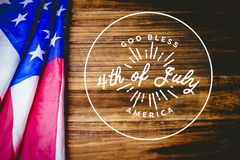 4th of July design on wooden background with american flag. Digital composite of 4th of July design on wooden background with american flag Stock Photography