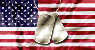 4th July Dog Tags. Dog tags, identity plates, with copy space, on American Flag background Royalty Free Stock Photography