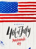 4th of July, Independence day - Brush calligraphy greeting and USA flag on a wooden plank background. Vector illustration Royalty Free Stock Photos