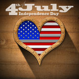 4th of July - Independence Day. Wooden porthole heart shape with US flag interior, on wooden wall with phrase 4th of July - Independence Day Stock Photos
