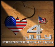 4th of July - Independence Day. Wooden wall with a hole in the shape of heart, US flag interior and phrase: 4th of July - Independence Day on black background Stock Photos