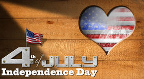 4th of July - Independence Day. Wooden wall with a hole in the shape of heart, US flag interior and phrase: 4th of July - Independence Day on black background Royalty Free Stock Photo
