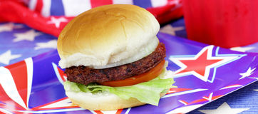 4th of July Panorama Burger. A hamburger in panorama view with traditional July 4th colors and decorations.  Grilling out is a tradition of many families on July Royalty Free Stock Photo