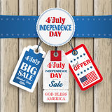 4th july retro emblem price stickers Wood. Independence day sale price stickers with blue banner on the wooden background Stock Images