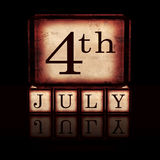4th of July in wooden cubes over black Royalty Free Stock Images