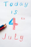4th of July Written. On a piece of colored pencils royalty free illustration