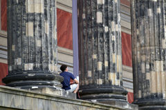 16th of June 2017 in Berlin, Germany: A male tourist is having a rest in front of the Altes Museum in Berlin, Germany royalty free stock image
